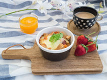 Breakfast with toasts, egg, coffee and fruits Stock Image