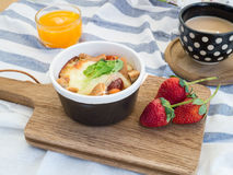 Breakfast with toasts, egg, coffee and fruits Royalty Free Stock Images