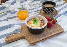 Breakfast with toasts, egg, coffee and fruits Royalty Free Stock Photo