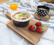 Breakfast with toasts, egg, coffee and fruits Stock Images