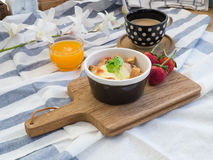 Breakfast with toasts, egg, coffee and fruits Royalty Free Stock Image