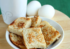 Breakfast with toasts and eggs Royalty Free Stock Images