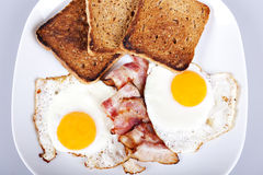 Breakfast - toasts, eggs, bacon Stock Image