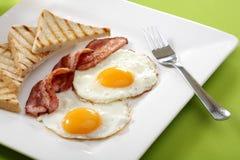 Breakfast - toasts, eggs, bacon Stock Photos