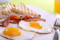 Breakfast - toasts, eggs, bacon Royalty Free Stock Photo