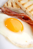 Breakfast - toasts, eggs, bacon Stock Photography