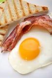 Breakfast - toasts, eggs, bacon Stock Photography