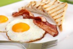 Breakfast - toasts, eggs, bacon Royalty Free Stock Photos