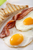 Breakfast - toasts, eggs, bacon Royalty Free Stock Image