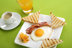 Breakfast - toasts, eggs, bacon Stock Images