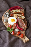 Breakfast - toasts, eggs, bacon Royalty Free Stock Images