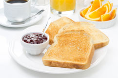 Breakfast with toasts, jam, coffee and orange juice Royalty Free Stock Photo