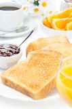 Breakfast with toasts, jam, coffee and orange juice vertical Royalty Free Stock Image