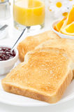 Breakfast with toasts, jam, coffee and orange juice vertical Stock Image