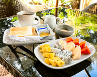 Breakfast with toasts and tropical fruits Royalty Free Stock Photos