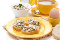 Breakfast - toasts with tuna and homemade cheese, coffee Stock Photo
