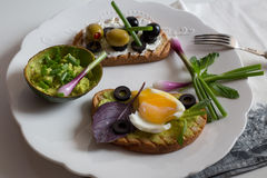 Breakfast toasts. A variety of breakfast toast on wooden table Stock Images
