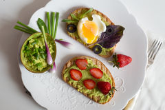 Breakfast toasts. A variety of breakfast toast on wooden table Royalty Free Stock Photography