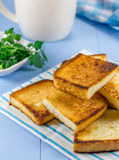Breakfast toasts with verdure and cup of coffee. On the wooden table Stock Image