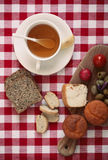Breakfast with  tomato, radish, olives, cheese and tea. Royalty Free Stock Image