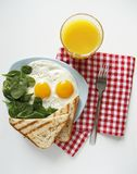 Breakfast. top view. eggs, orange juice, spinach royalty free stock photography