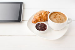 Breakfast with touchpad tablet Royalty Free Stock Images