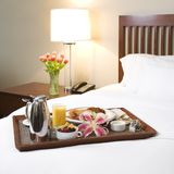 Breakfast tray. Bed in breakfast tray laying on bed Stock Images