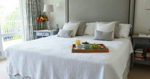 Breakfast tray on bed in bedroom stock footage