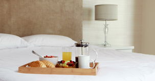 Breakfast tray on bed stock footage