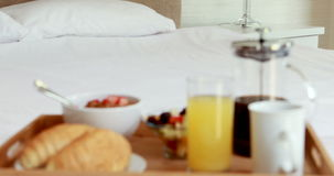 Breakfast tray on bed stock video footage