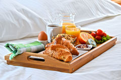 Breakfast tray in bed in hotel room Royalty Free Stock Photos