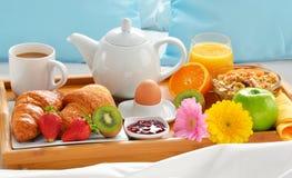 Breakfast tray in bed in hotel room Stock Photo