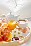 Breakfast tray in bed in hotel room Stock Image