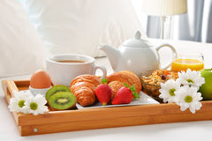 Breakfast tray in bed in hotel room Royalty Free Stock Images
