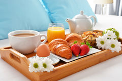 Breakfast tray in bed in hotel room Stock Photography