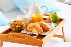 Breakfast on tray in bed in hotel room Stock Photography