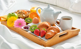 Breakfast tray in bed in hotel room Royalty Free Stock Image
