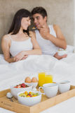 Breakfast tray on bed Stock Photography