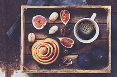 Breakfast tray with black coffee, cinnamon roll, fresh figs and pecans Stock Images