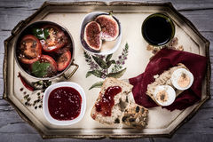 Breakfast on a tray with bread, eggs and vegetables. Breakfast on a tray with bread, marmelade, tea, tomatoes, salad ans figs Stock Images