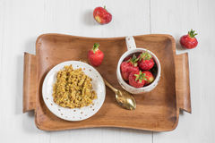 Breakfast on a tray, buckwheat porridge and ripe red strawberry Royalty Free Stock Photo