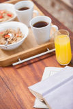Breakfast on tray on coffee table Stock Images