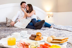 Breakfast tray with couple in background. Stock Photo