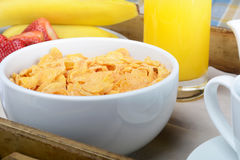 Breakfast tray with orange juice, cereals and fruits. Royalty Free Stock Photography