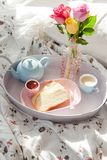 Breakfast tray with roses. Breakfast tray with fresh coffee and brioche Stock Images
