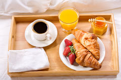 Breakfast tray served in bed Stock Image