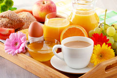 Breakfast on tray served with coffee, juice, egg, and rolls Stock Photo