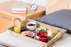 Breakfast Tray on Unmade Bed in Hotel Room Stock Image