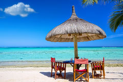 Breakfast on tropical beach. Breakfast on tropical white sand beach in Mauritius Island Stock Photo