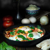 Breakfast with Turkish spicy shakshuka, still life Stock Photos